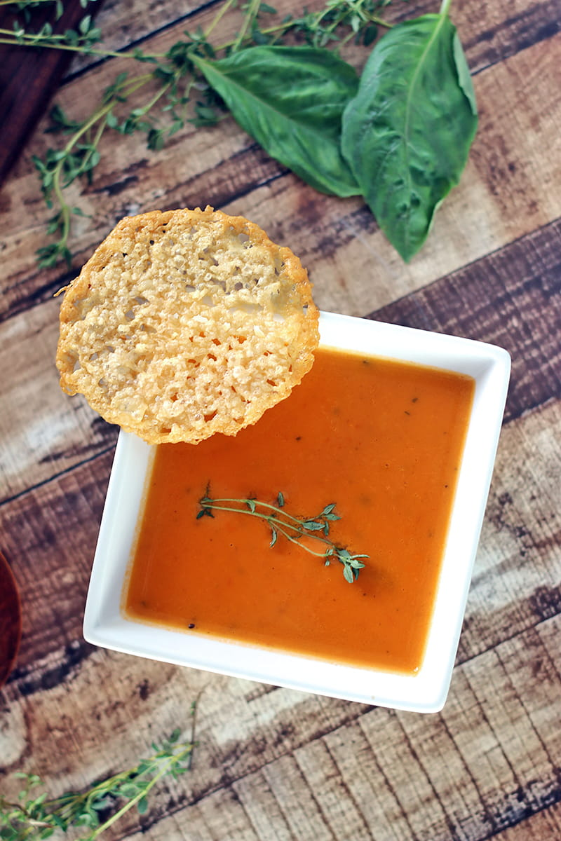 Low Carb Tomato Soup with Parmesan Crisps - this delicious from-scratch soup is easy to make and perfectly complimented with Parmesan crisps.