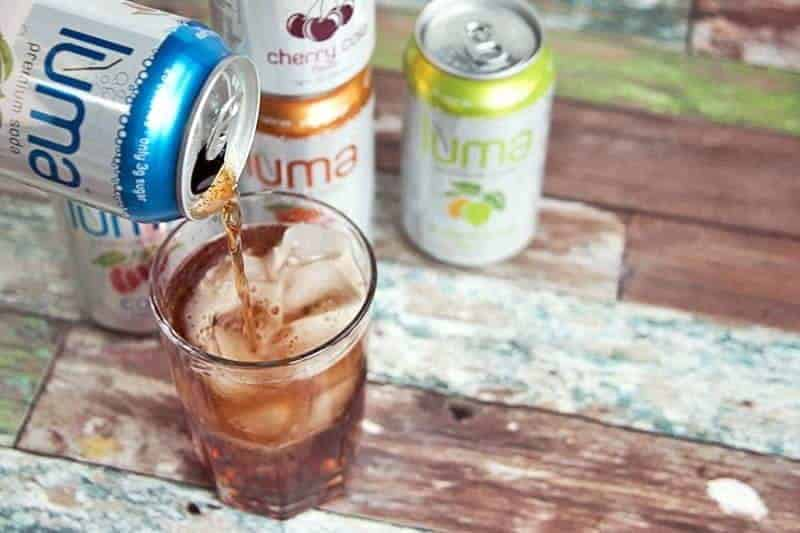 pouring a can of Luma Soda into a glass