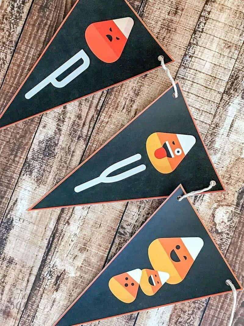 This free candy corn emoji Halloween printable banner is a super cute addition to your home or classroom Halloween decor & saves you money too!
