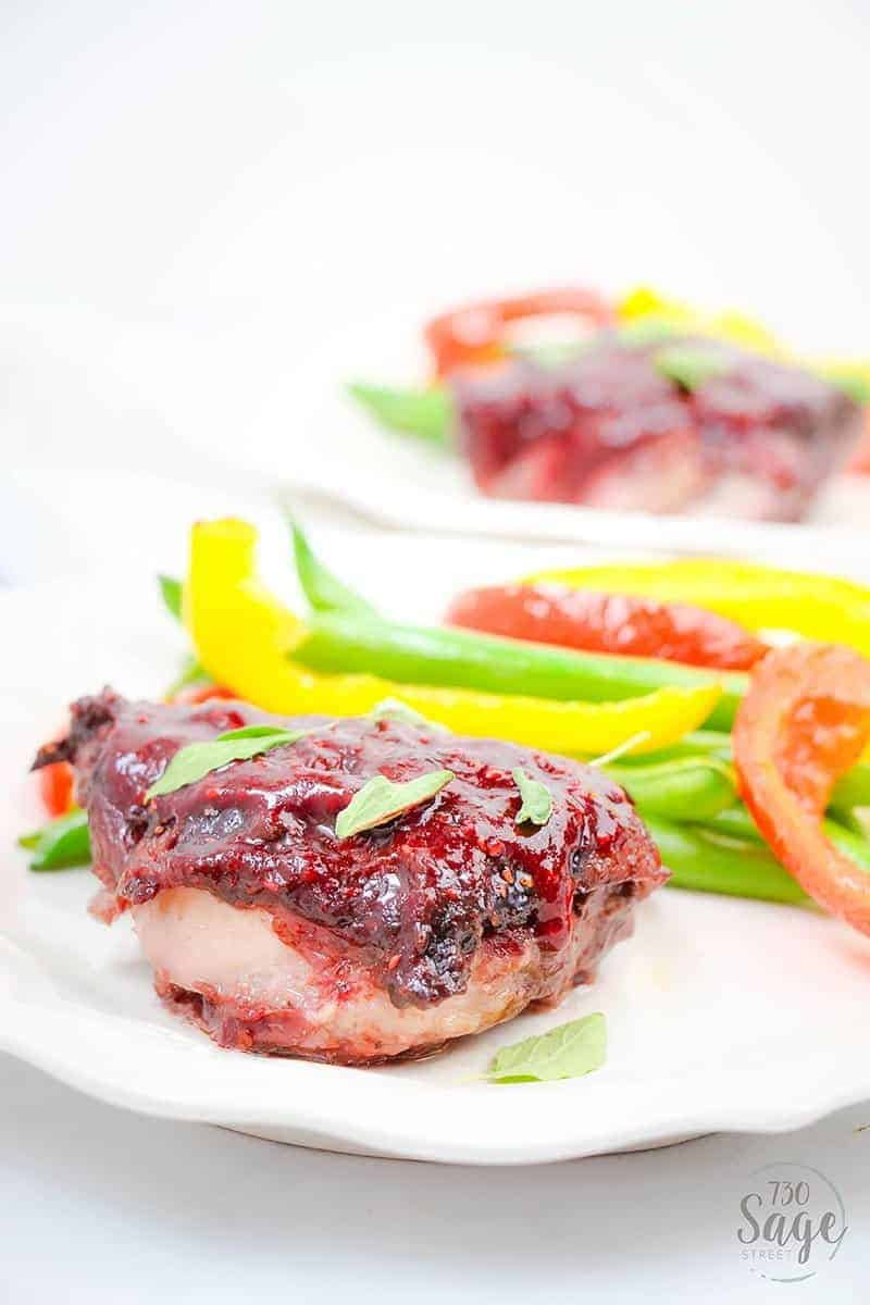 This low carb raspberry chicken will shake up your keto recipe routine with a delicious sweet & savory raspberry marinade over boneless chicken thighs.