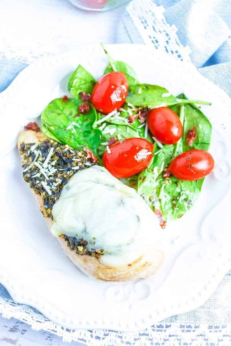 This super easy keto, low carb pesto Caprese chicken is sure to be a family favorite. Full of flavor, you can get it on the table in around a ½ hr. or so.
