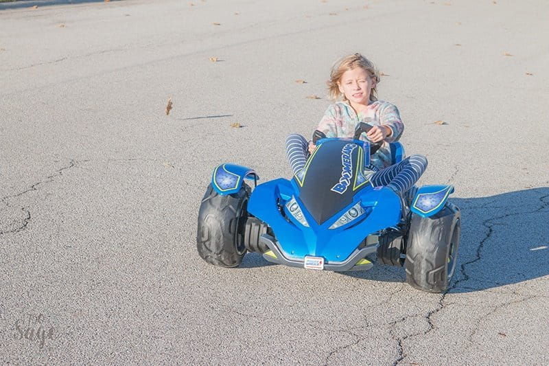 Girl on Power Wheels Boomerang driving on street