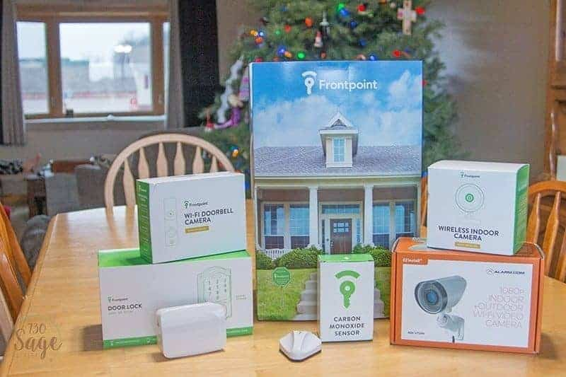 Frontpoint Security Setup all system boxes on a table inside a house