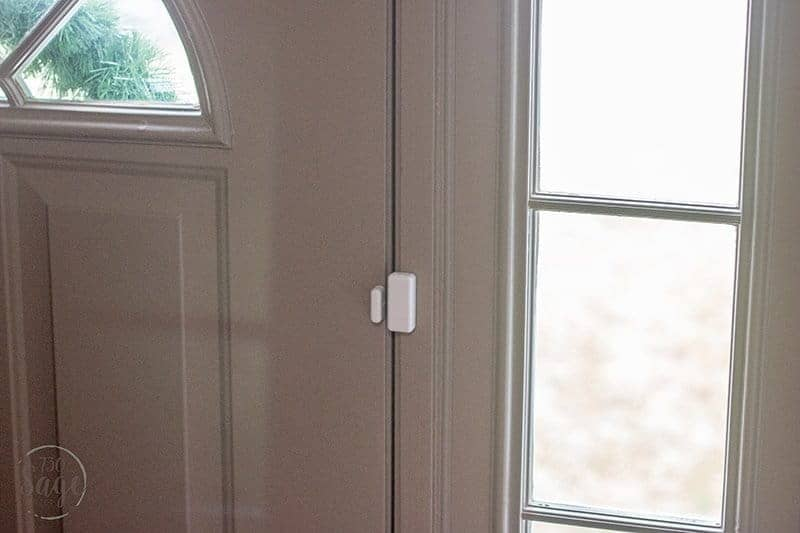 Frontpoint Security Setup door sensor installed on a grey door