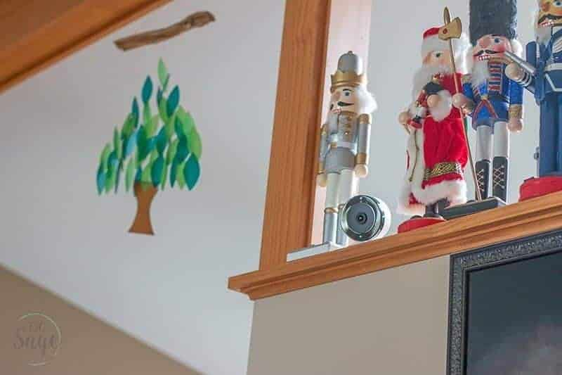 Frontpoint Security Setup indoor camera on a shelf with wooden figures