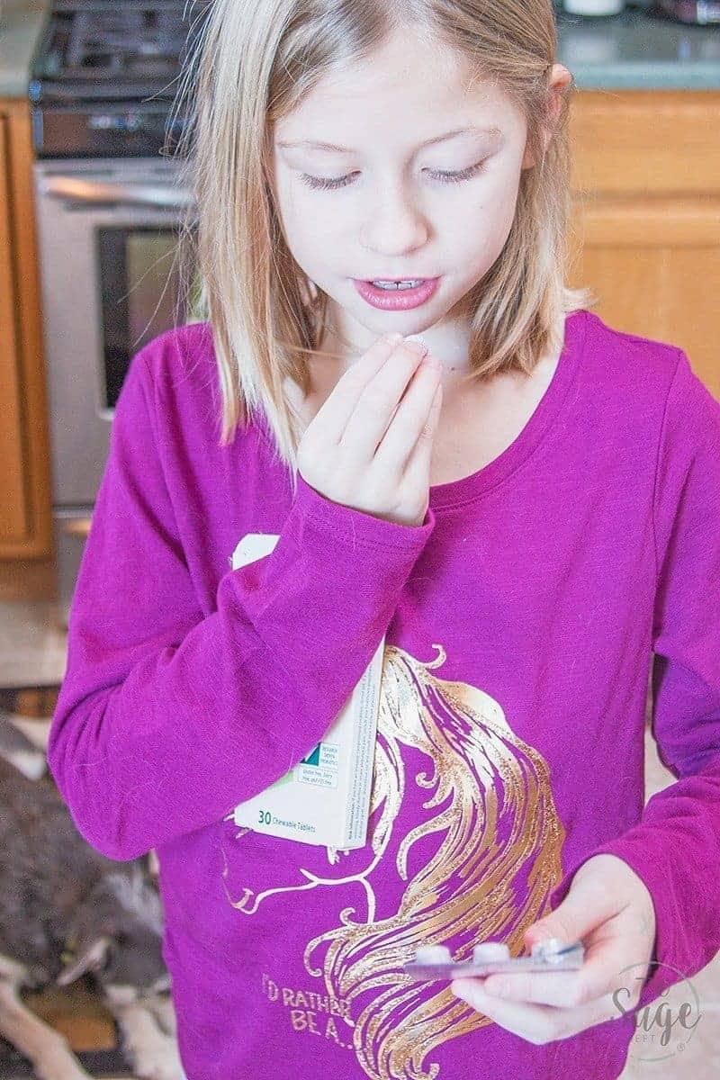 girl holding HMF probiotics