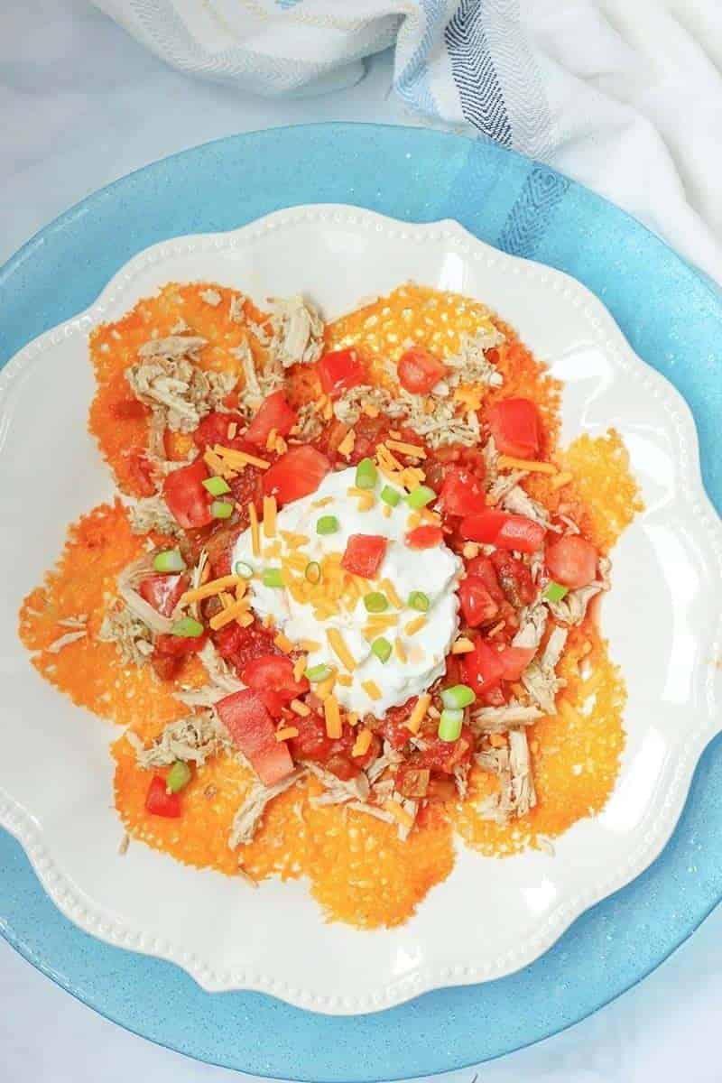 keto nachos - low carb nachos close up with sour cream on a blue plate