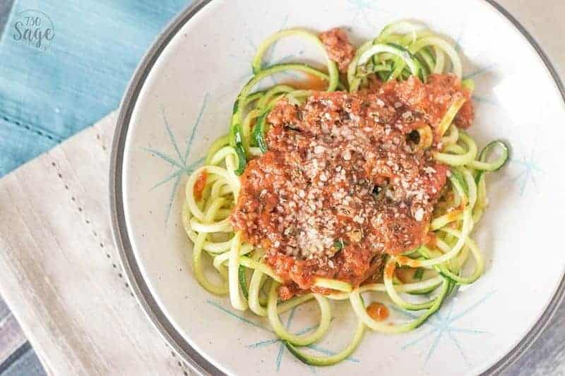 Top view of a Low Carb Creamy Bolognese with Zucchini Noodles in a white bowl.