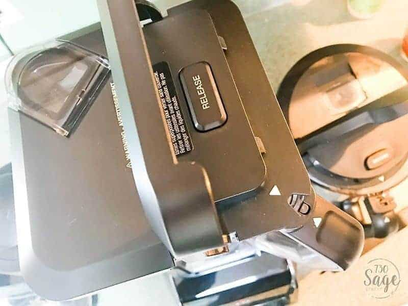 Close-up of the Ninja Intelli-Sense Kitchen System with Auto-Spiralizer crushing container lid.