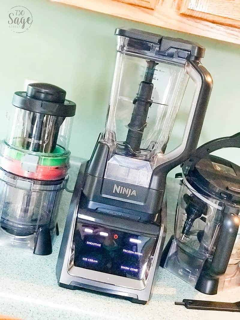 Photo of the Ninja Intelli-Sense Kitchen System with Auto-Spiralizer on a light green counter.