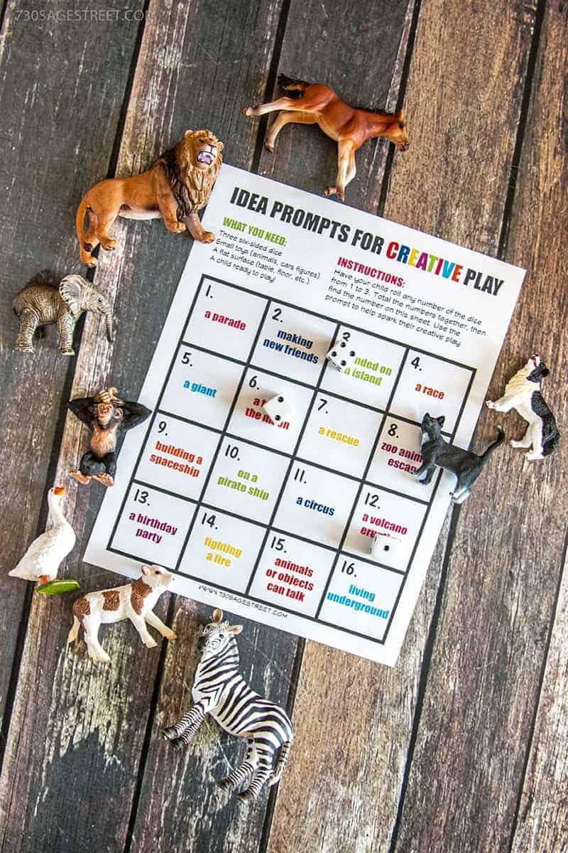 creative play printable activity with plastic toy animals around it