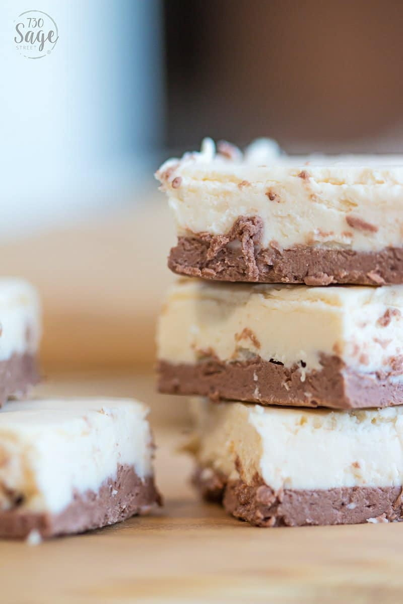 3 pieces of brown and white keto fudge stacked on top of each other