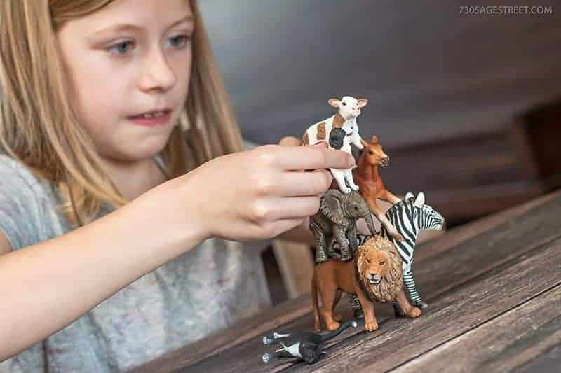 girl playing with Schleich toys