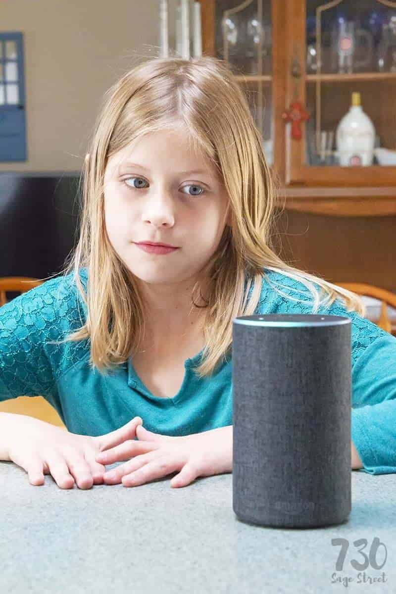 girl in blue shirt with an Amazon Echo with Alexa Skill Blueprints