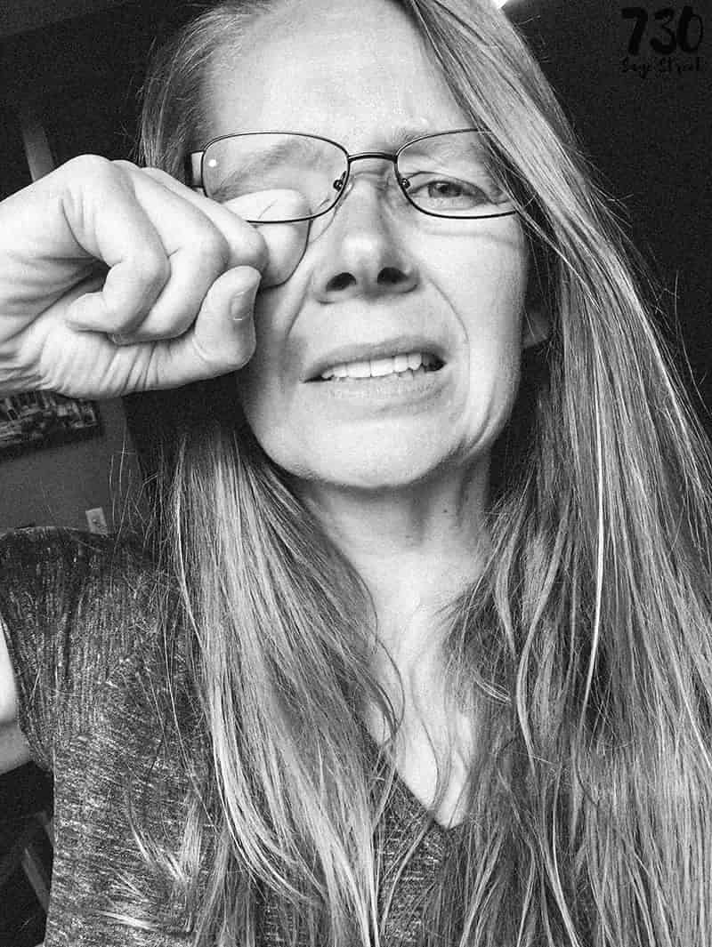 woman rubbing dry eyes