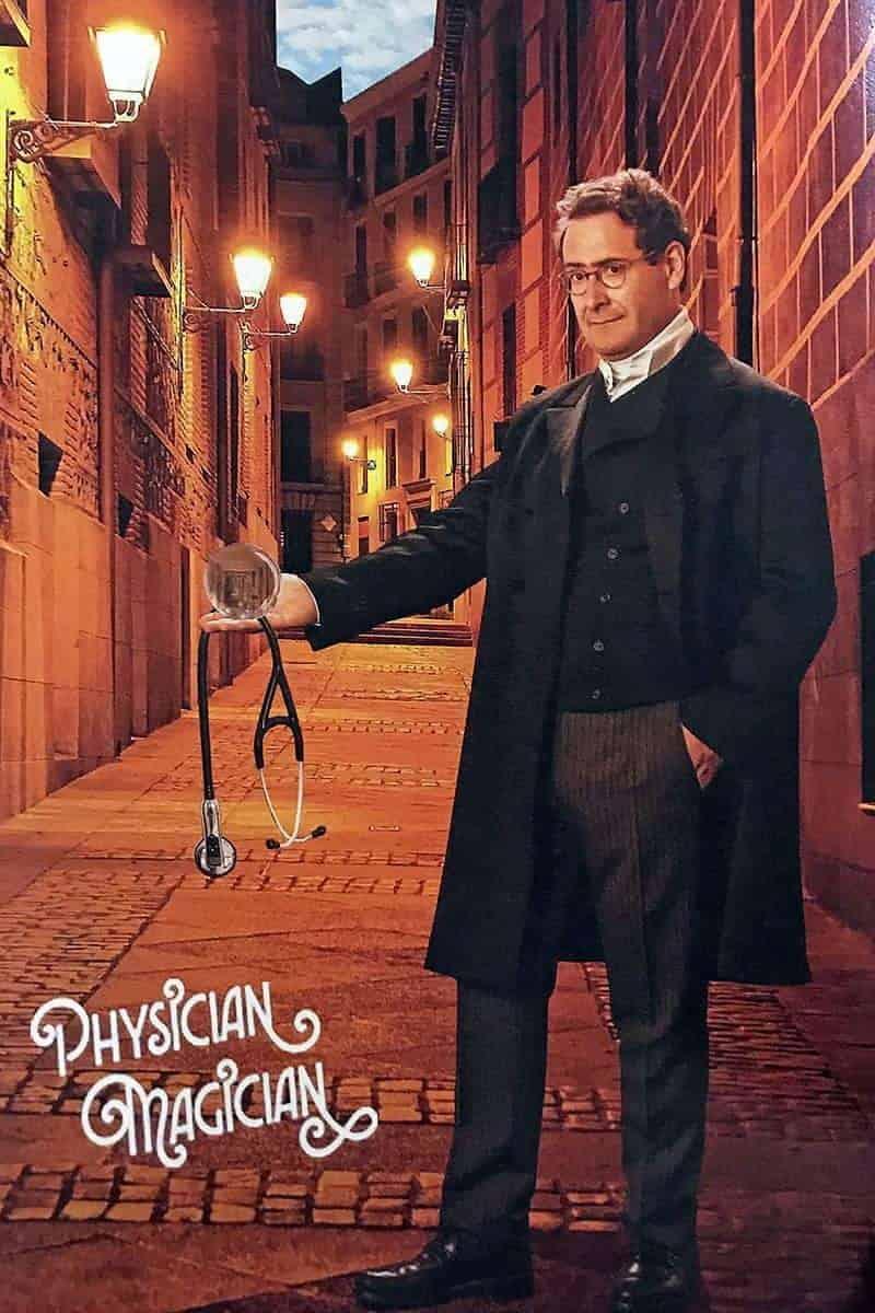 Ricardo Rosenkranz from The Rosenkranz Mysteries with buildings behind him