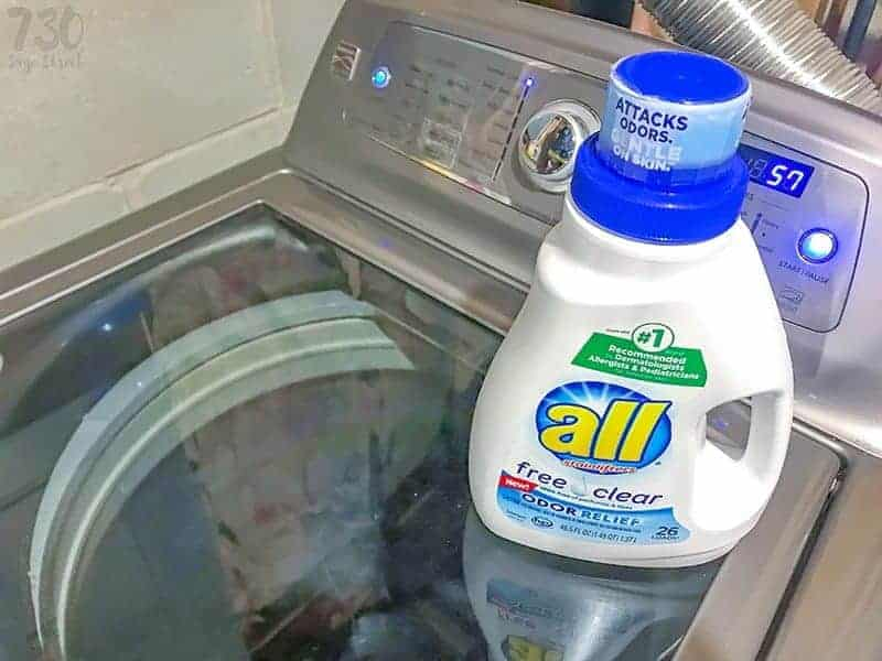 All free clear detergent bottle on a washing machine