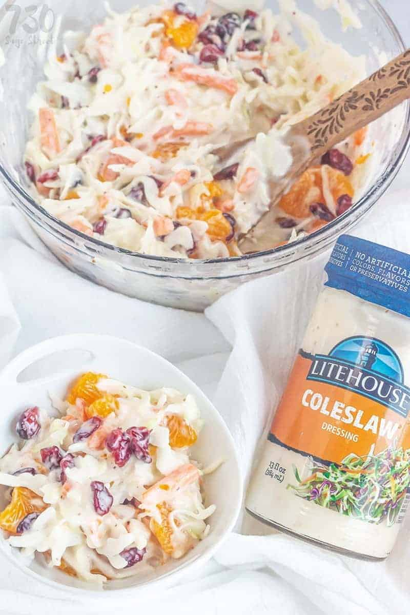 cranberry orange coleslaw in a white bowl