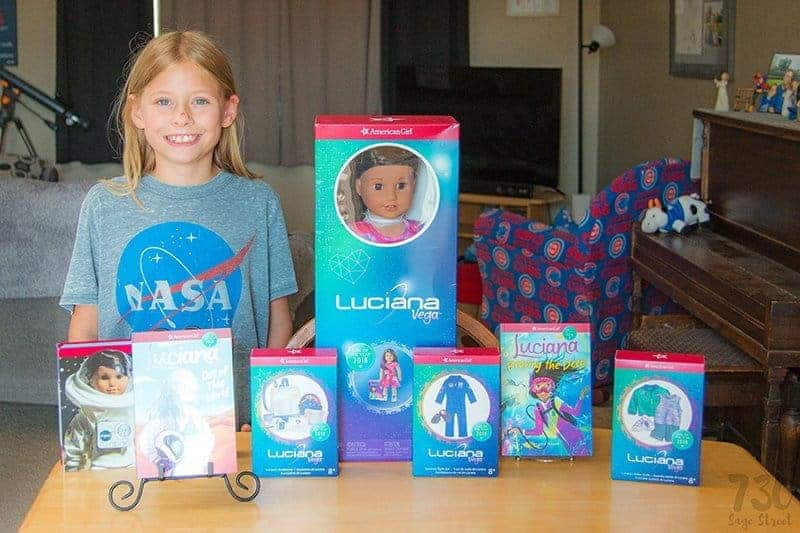The Girl of the Year 2018 - American Girl Doll Luciana Vega and some accessories in boxes on a table