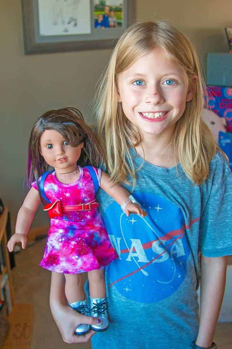 Blonde girl holding Luciana Vega doll