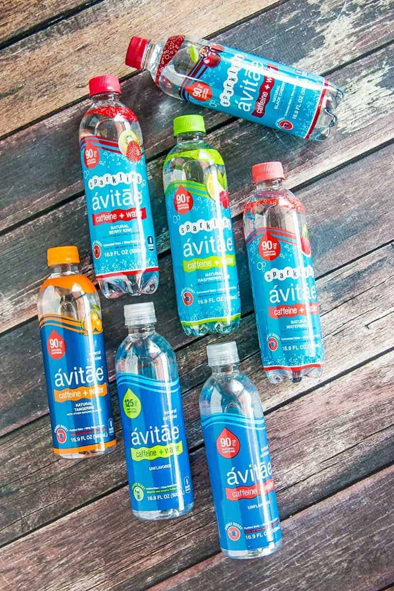 avitae caffeinated water bottles on a wood background