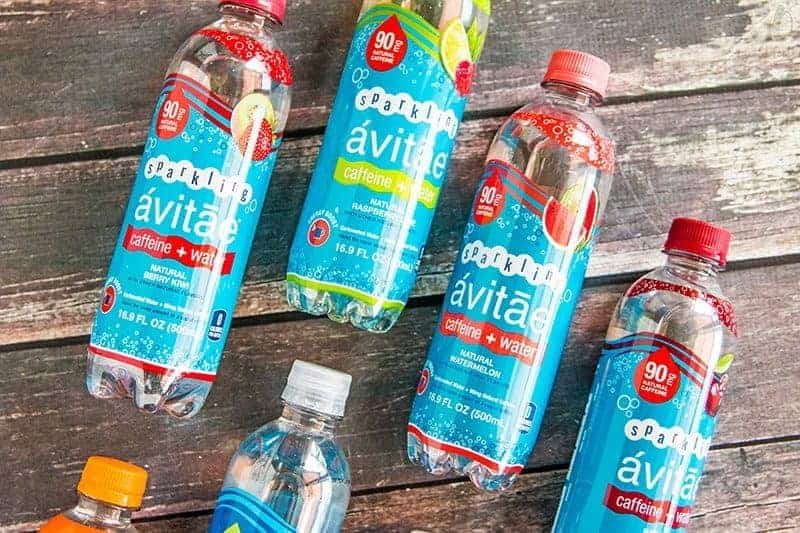 bottles of Avitae Caffeinated Water on a wood background