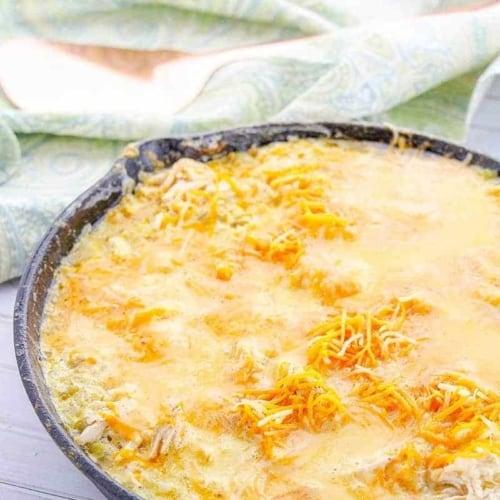 sour cream chicken enchiladas in a cast iron pan