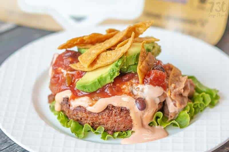 taco burger on a white plate