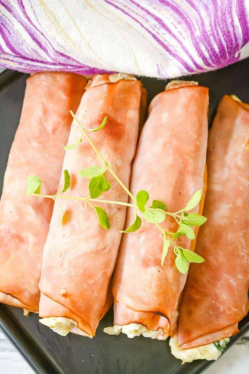 These low carb ham roll ups are a gluten free, keto friendly appetizer recipe you can whip up in less than 30 minutes. Super easy, delicious & versatile. #appetizer #glutenfree #lowcarb #keto #ketodiet #ketogenic #ketorecipes #delicious #easy #quick