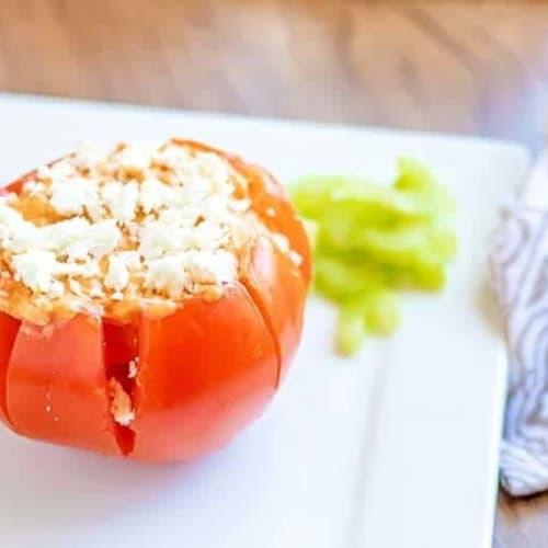 buffalo chicken dip stuffed tomato on a white plate