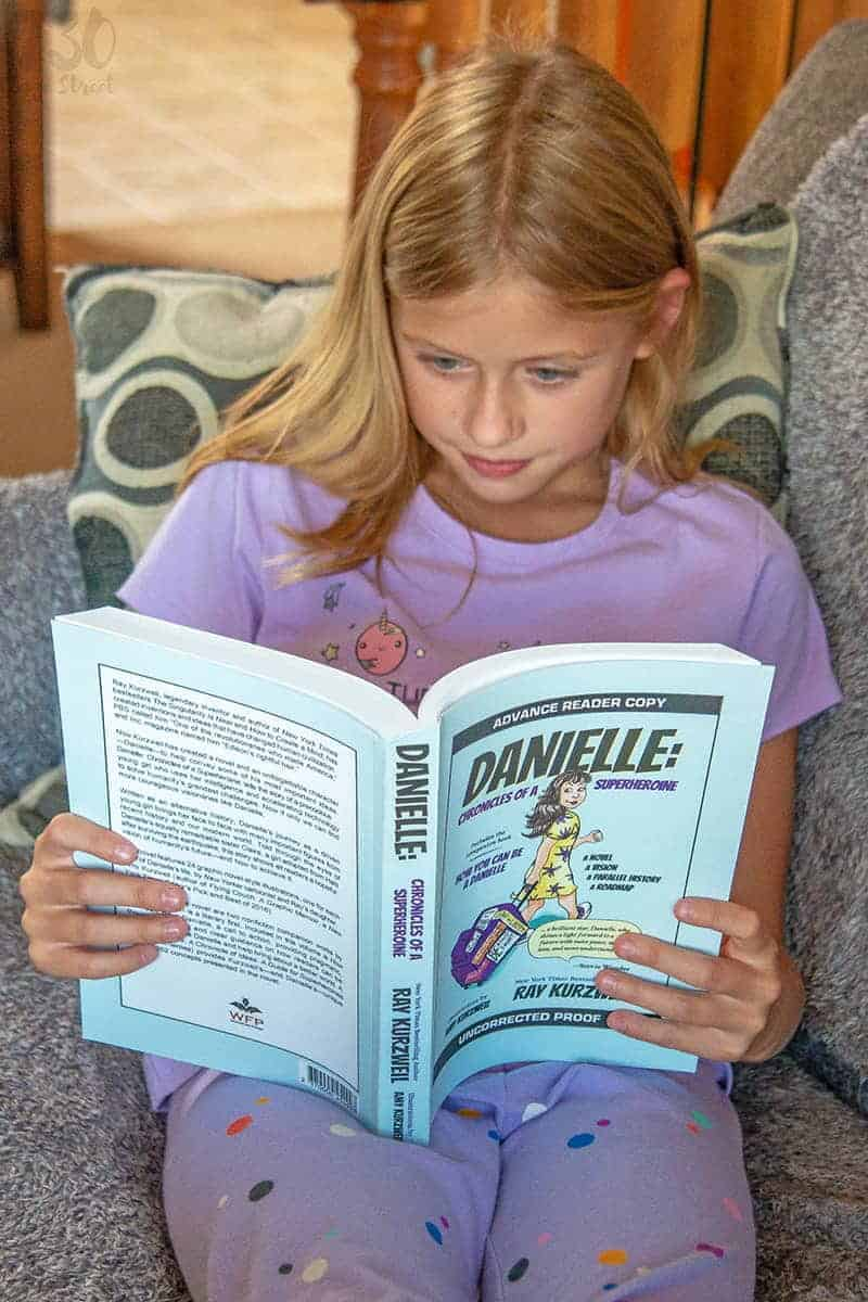 girl reading Danielle: Chronicles of a Superheroine