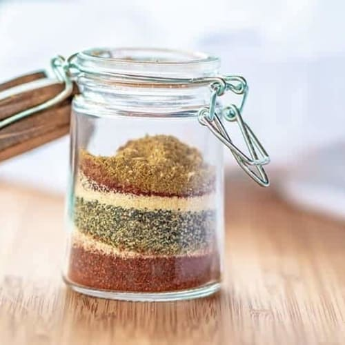 adobe seasoning in a glass jar on a wood board