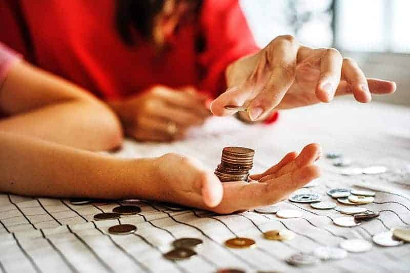 woman counting change