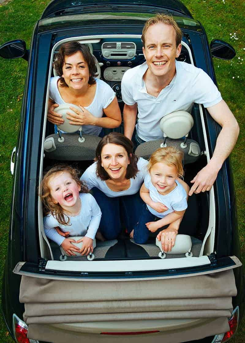 view looking down of a family in a convertible