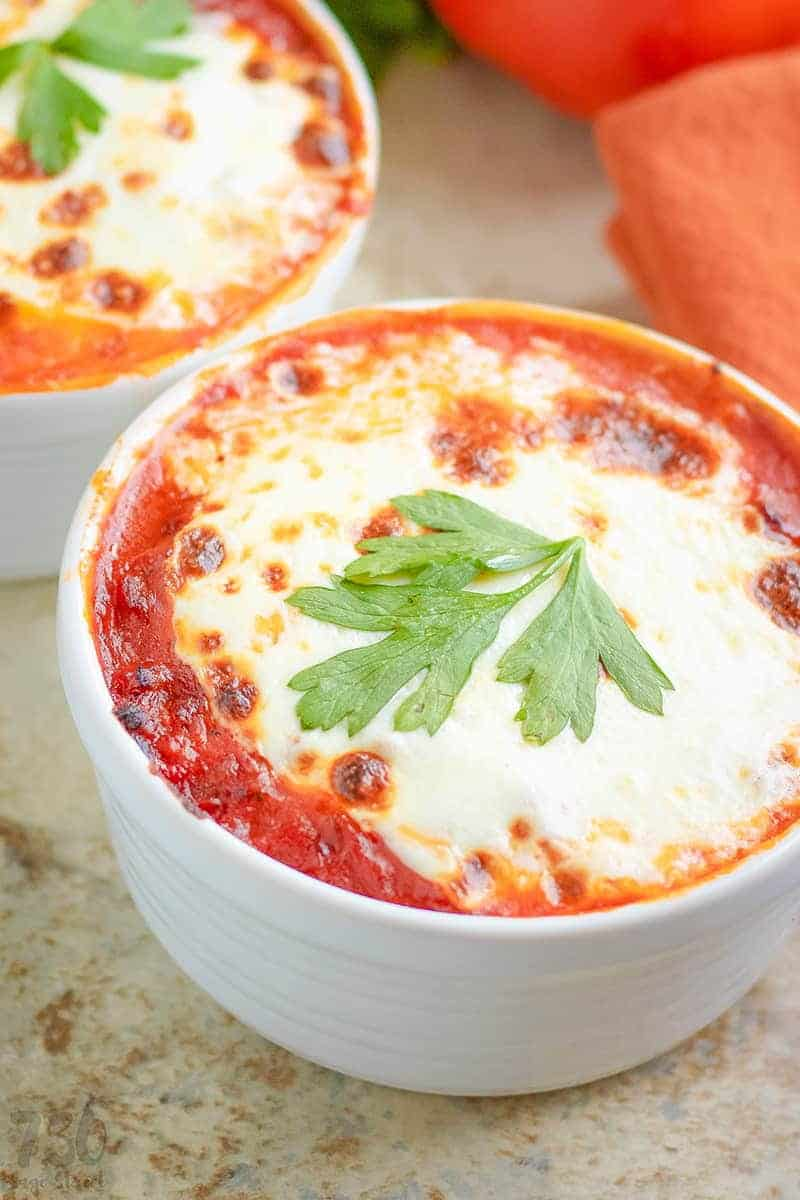 close up of low carb lasagna in a white bowl
