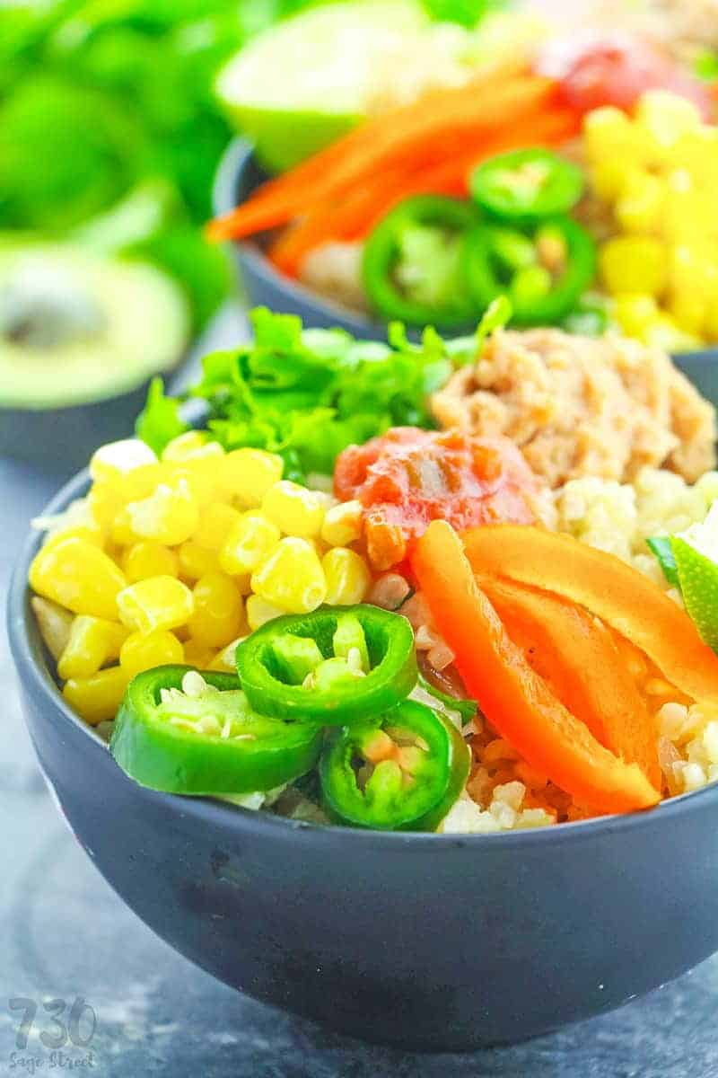 vegan burrito bowl recipe in a black bowl