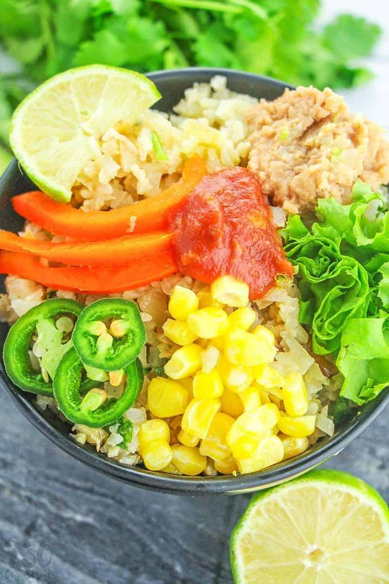 close up of vegan burrito bowl recipe in a black bowl