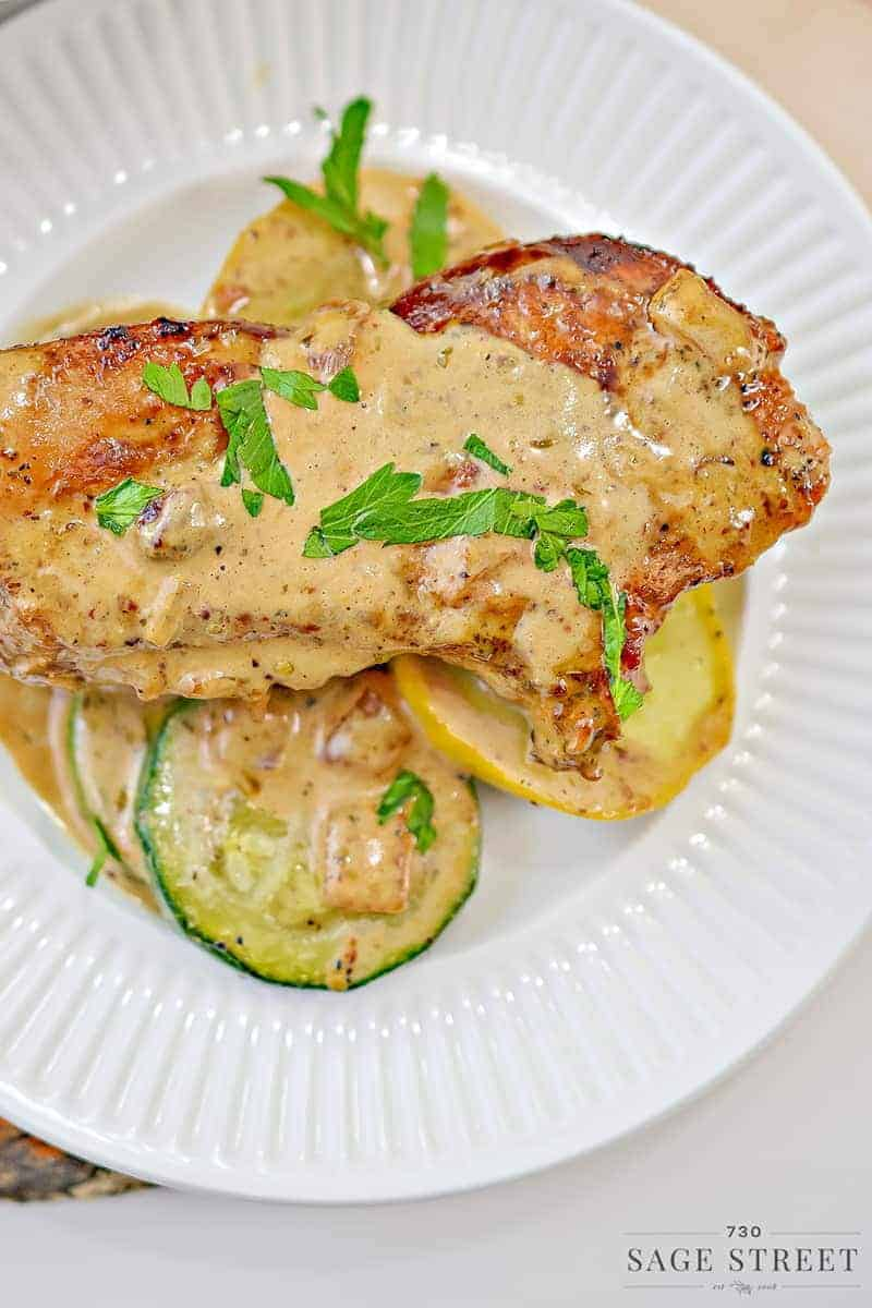 keto creamy mustard pork chops on a white plate