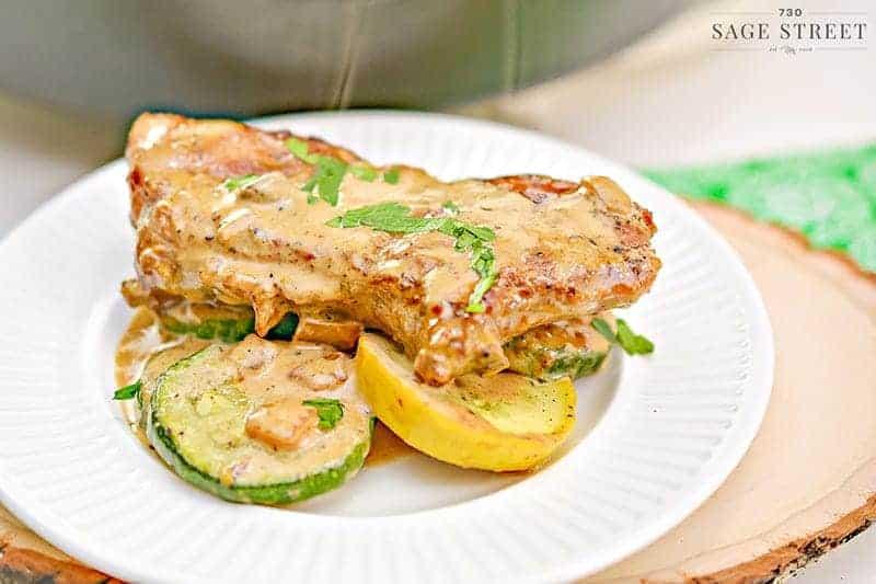 keto mustard pork chops on veggies on a white plate