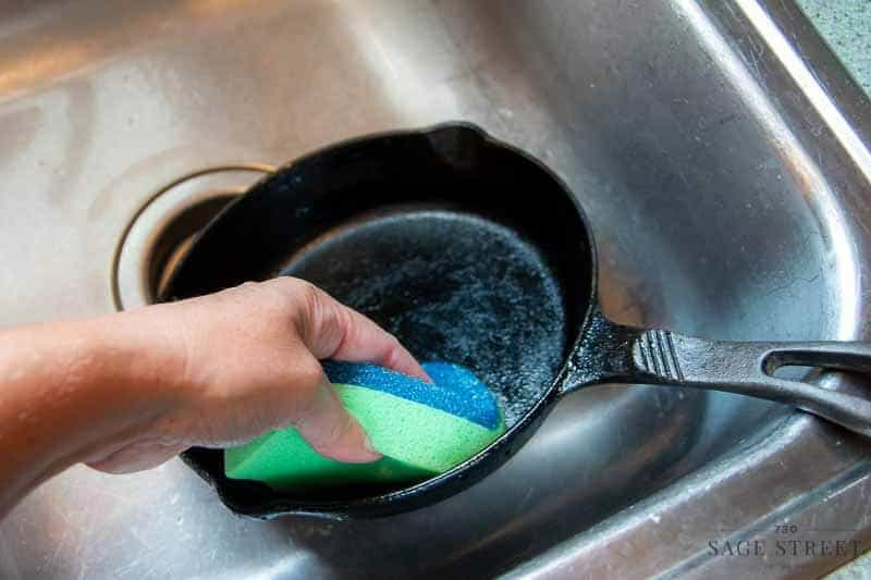 DishFish sponge cleaning grease off a cast iron pan