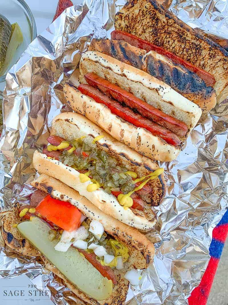 Chicago style hot dogs with toppings on foil