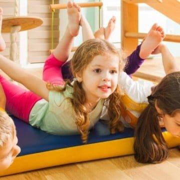 Three cute kids having fun with fitness