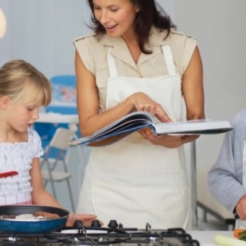 Mother and kids preparing dinner together.