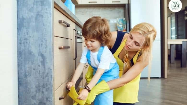 preschooler helping mom with chores, cleaning counters