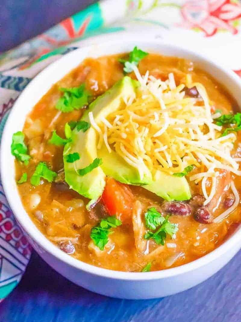 enchilada soup in a white bowl